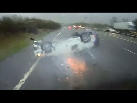 Newly-released dashcam video shows the moment when a car driving along a United Kingdom (UK) highway flips onto its roof before sliding off the road in a shower of sparks.
