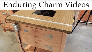 Do you need to spend hundreds of dollars on a commercial router table and top?  Hell no!  You can make your own router table using scrap wood and as little as $50 to $100 in specific hardware and electrical parts.  In this video I'll show you the steps to make your own inexpensive router table that will do everything the commercial models can do.  My first router table is two decades old and still going strong, but I wanted to add a second one to my shop.  The process is easier than you might think.  For my second table I mounted a Triton router, which I also reviewed here:https://www.youtube.com/watch?v=e49JeOFMlv0&index=2&list=PLD4oAOZqK9mDRnc-GiaRH8YjZu-ndUnHV