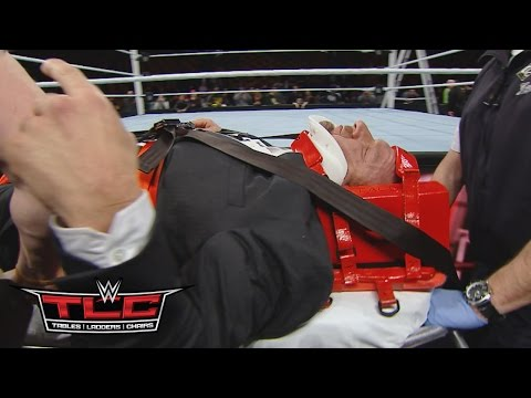 Triple H helped by paramedics after being attacked by Roman Reigns: WWE.com Exclusive, Dec. 13, 2015