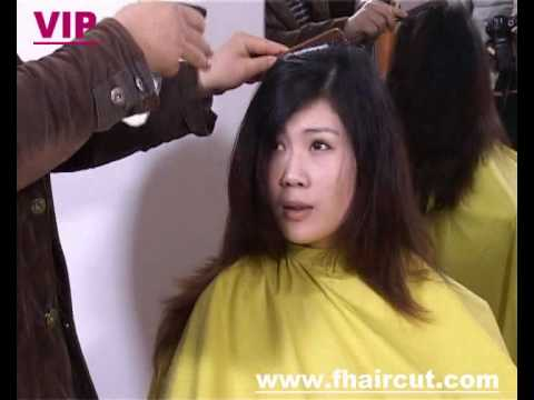 Lady model in long dye hair cut to short