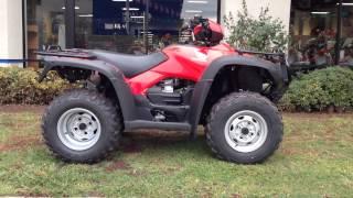 7. 2014 Honda Rubicon 500 4x4 Automatic Red