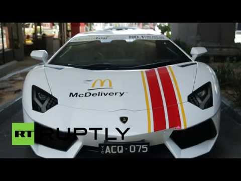 furious - As if their food wasn't fast enough, American restaurant chain, McDonald's, used Lamborghinis to deliver meals to customers in Melbourne, Australia, on Wednesday. The flashy cars, which were...