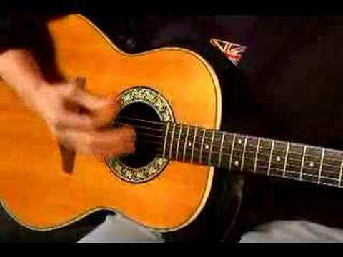 How to Play Acoustic Guitar : How to Strum an Acoustic Guitar: Part 1