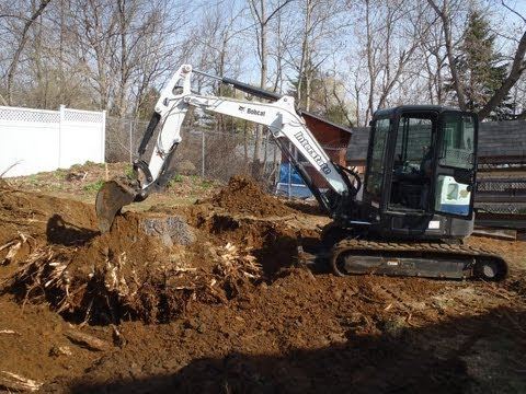 "Bobcat E50 Removing Big 32"" Stump"