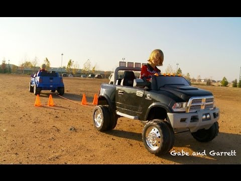 150 - The first in our series of Power Wheels Tug-of-War Battles! Watch the match up between the Power Wheels Ford F150 Raptor vs the Kid Trax Dodge Ram 3500 Duall...