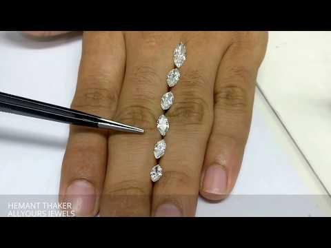 Marquise shape diamonds size comparison on hand