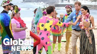 Prince Harry and Meghan attend 'Fluro Friday' session on Australia's Bondi Beach