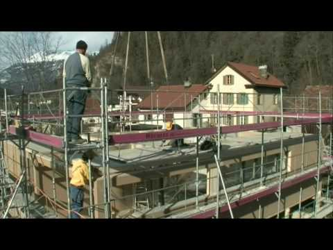 Erection of prefabricated timber house by Schoeb/Just Swiss Ltd.