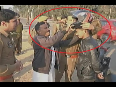 In Graphics: Udhampur cops distribute helmets to motorists