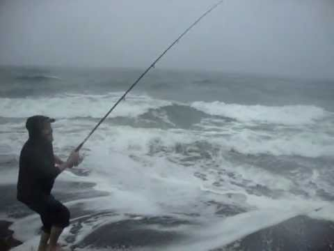 Reeling in a Striped Bass on the Beach in NJ