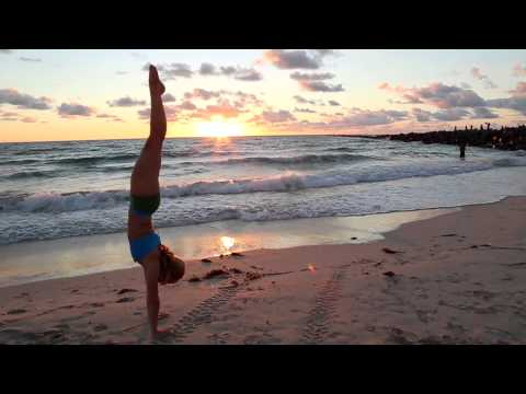 How to Kick into Handstand on the Beach with KinoYoga video