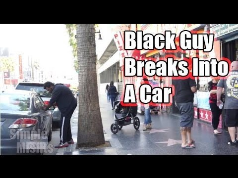 A white guy and a black guy take turns trying to break into a car - guess who gets arrested?