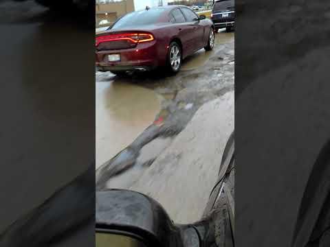 Potholes on a major avenue in southeast Michigan