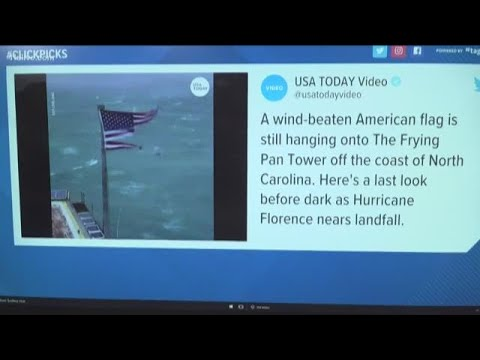 Wind-beaten American Flag holds on as Florence barrels down the coast