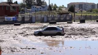 Subaru Impreza Battles It's Way Out Of A Large Mud-Pit