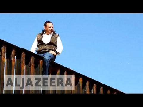 Mexican politician seen in video atop US border fence