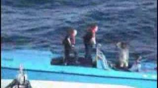 US Coast Guard pops the Go Fast Boats drug smugglers from mexico check out the machine gun sinking of this boat at the end ...