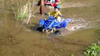 10. ATV Yamaha Raptor 80  3 yr old kid playing  mud and water