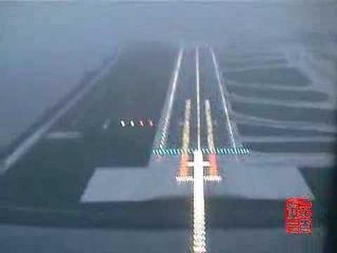 HKG_AB6 Rwy07L ILS Landing Heavy Rain Hong Kong