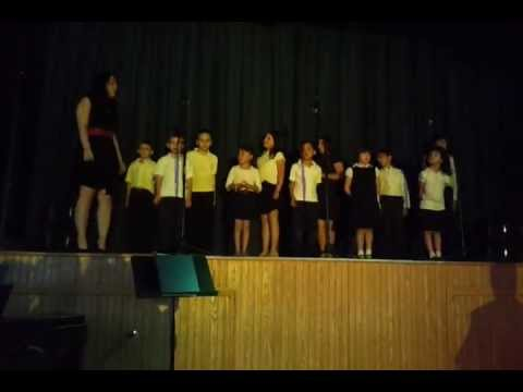 Dondi choir - Our Lady of Grace Childrens Choir sings in music show. Lil Phil is 3rd from left.