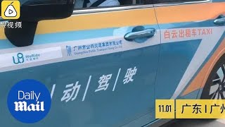 China's first driverless taxi service launched in Guangzhou