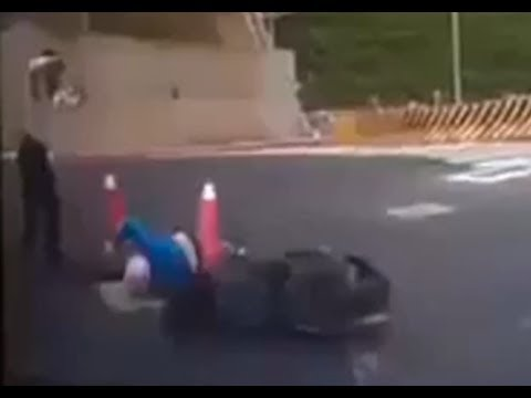 Scooter Rider Falls into Manhole in Taiwan