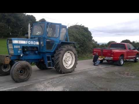 dodge ram cummins vs ford 8600 tractor tug of war