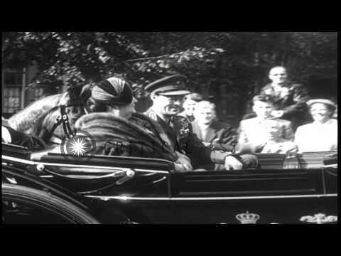 French President Rene Coty is greeted by Queen Juliana and Prince Bernhard as he ...HD Stock Footage