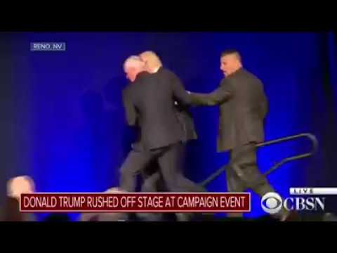 Кандидата в президенты США Дональда Трампа экстренно увели со сцены сотрудники охраны (видео)