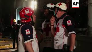 Video Rescuers at work among collapsed buildings in Mexico City MP3, 3GP, MP4, WEBM, AVI, FLV Oktober 2017