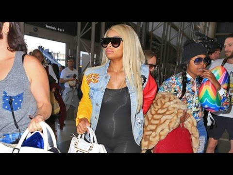Blac Chyna Flaunts Growing Baby Bump In Skintight Onesie Jetting To London From LAX