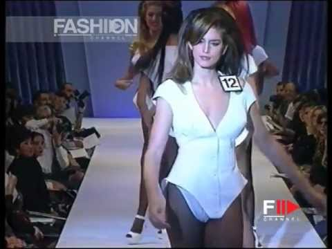 Cindy Crawford pushing  the other Models on Catwalk at