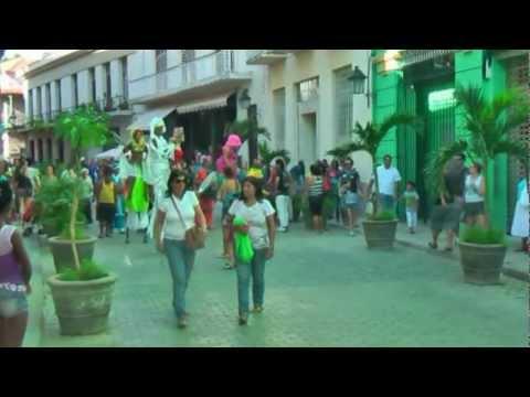 Cheerful parade walking on stilts in Havana Cuba Vrolijke optocht steltlopers Calle Mercaderes
