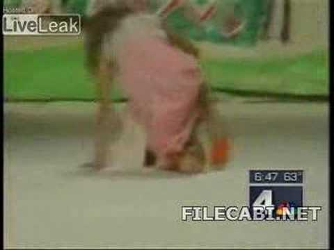 Models falls over twice - anchor man can't stop laughing