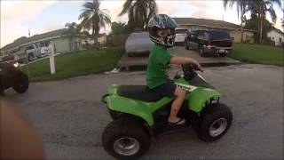 10. My 4 year old tearing it up on his Kawasaki KFX-50 ATV 50cc quad LT-50