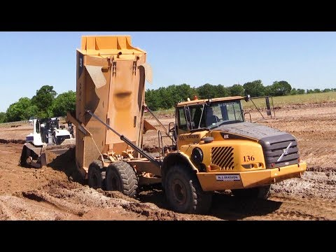 Cat D6T LGP Dozer With Trimble 3D GPS Pushing Volvo A35 Dumper Loads