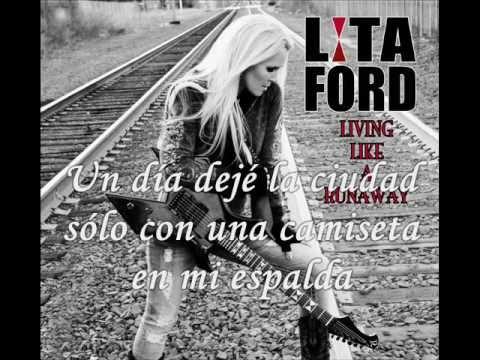 Tekst piosenki Lita Ford - Living Like A Runaway po polsku