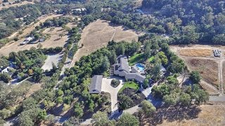 Amazing estate on approximately 10 acres. 8058 square foot home with 2180 square foot 6 car garage. Main house has 4 ...