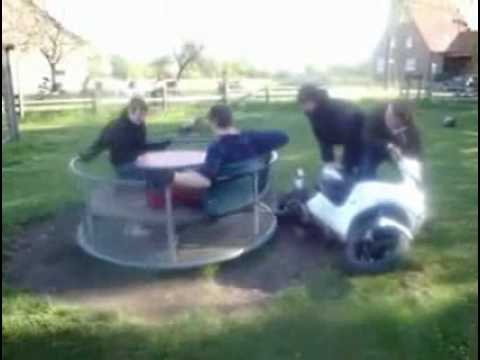 Guy falls off from a very fast carousel
