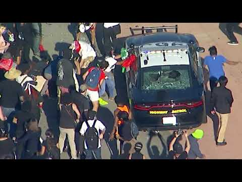 Black Lives Matter protesters smash window of CHP cruisers near downtown LA I ABC7