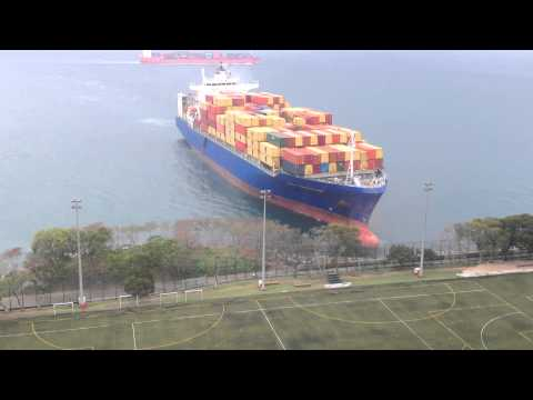 ship - Jaw dropping: a giant ship heads straight towards Hong Kong university's sports ground. Copyright: Corinne Vigniel/ To use this video in a commercial player or in broadcasts, please email licensing...