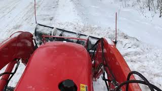 7. Kubota L4600 HST moving snow with front blade