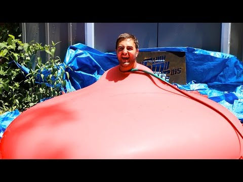 WATCH: 6 FT MAN IN 6 FT GIANT WATER BALLOON... SLOW MOTION