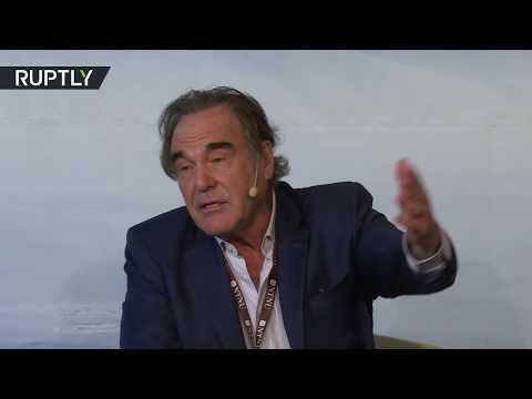 'Why would he fake it?' - Oliver Stone on allegations Putin showed him 'wrong' Syria video