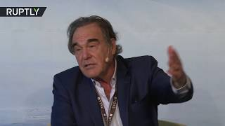 """Renowned US director Oliver Stone has urged the media """"not to trivialize"""" his documentary on Russia's President Vladimir Putin,..."""