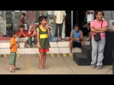 "A street child singing ""I will always love you"""