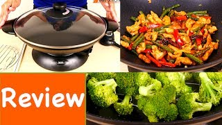 Hi Guys, today I'm reviewing the Aroma Electric Wok. LINK to WOK:  http://amzn.to/2gUj0BRThis unit comes in a 5 quart model and a 7 quart model. The wok measures 13.5 inches across. The entire unit with base measures inches tall. The electrical cord is 34 inches long. Aroma sent me a sample of this 5 quart model. The wok is cast metal and has a non-stick coating. There are long chopsticks included that you can use to stir food. Don't use any metal utensils since the wok is non-stick, only wood or plastic. Included is a large tempered glass lid with adjustable steam vent. A steam rack is included. If you want to make tempura, use this tempura rack to drain food after frying. The base is detachable. Turn the wok over, press this knob down and unlock to remove the base. To put the base back on, place it on the wok, press down the knob and turn to lock. The wok, base, lid and all accessories are dishwasher safe. I prefer to hand wash since I don't feel comfortable putting the heating element in the dishwasher. Of course do not wash the temperature control probe, just wipe it down if it gets dirty. The instruction manual has a few recipes for stir fried beef, chicken, fried rice and shrimp. The probe attaches to the base here and the temperature can be set from 250 degrees Fahrenheit to 450 degrees. When you first get the wok, make sure it's unplugged. Wash the wok in warm soapy water and dry. Take a tablespoon of oil and wipe the wok all over. This is to condition the wok. Wipe the work dry with a paper towel, now we can test the unit. Plug in the temperature probe to the base. It has a trigger release which should keep it from detaching from the base. Plug into an outlet. Turn the unit to high, pour 2 tablespoons of oil and tilt to coat the wok. Turn the temperature to 450 degrees. The indicator light comes on.  When the indicator light goes off, wok has reached the set temperature and we can start cooking. I'll make chicken and green beans. This is 2 boneless skinless chicken breasts cut up and coated with a little cornstarch, sugar and soy sauce. These are fresh green beans and red bell peppers cut up. Make sure to have all your ingredients ready before you turn the wok on since cooking goes pretty quickly. Put the chicken in and stir. The handle is cool to the touch but I would still suggest using an oven mitt because you don't want to accidentally touch the hot wok. Take the chicken out. Put the beans in and stir. Add whole red chillies broken. Now I'll add soy sauce and a little Sriracha, a little water, put the chicken back in, cover the pot. Lower the heat to 350. Cook for 2-3 minutes until the beans are tender. You can open or close the steam vent depending on how much moisture you want in the wok. Now I'll try steaming broccoli. Put a cup of water in the pot and the steam rack. Cover and bring to a boil at 450 degrees. The water is boiling. Place the broccoli on top and cover. The broccoli is done in less than 5 minutes.To clean, the dial should be off, unplug the unit from the wall. When the wok is cool, remove the control probe. Clean and dry all the parts. If you want to try this wok, I've put a link in the description above. Share this video and subscribe for more reviews. Until next time, thanks for watching :)