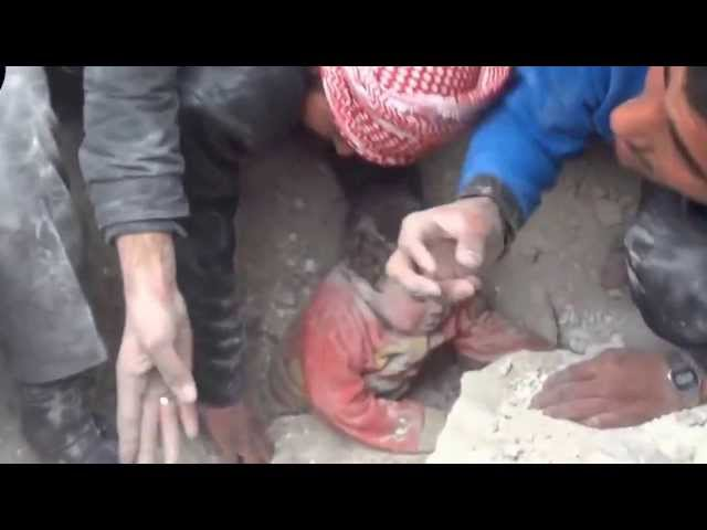 Child Rescued   from Under Rubble