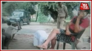 Inspector Busy On Phone While Complainant Lying On His Feet, Video Goes Viral