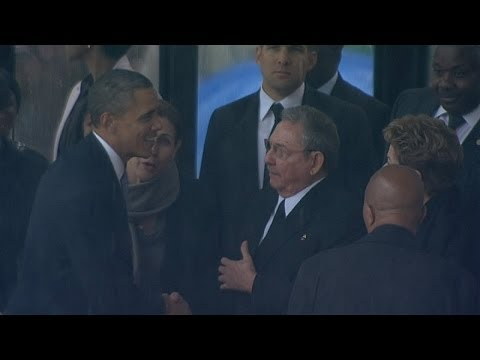 nelson - Subscribe to ITN News: http://bit.ly/itnytsub President Obama shook hands with his Cuban counterpart Raul Castro in a landmark moment for the two countries a...